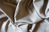 Folded simple beige viscose and polyester fabric poster