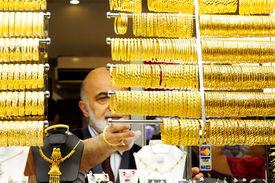 Golden bracelets on display