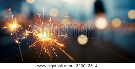 Burning Sparkler With Bokeh Light Background - Happy New Year