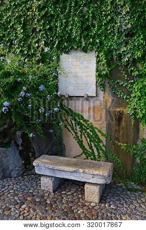 Memorial Plaque To The Greek Poet And Writer Nikos Kazantzaki (1883-1957). Nicos Square In Antibes (
