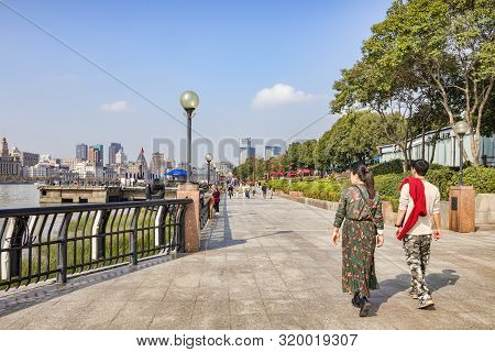1 December 2018: Shanghai, China - Visitors Walking On The Bank Of The Huangpu River On The Pudong S