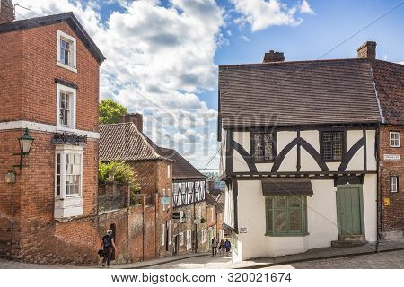 2 July 2019: Lincoln, Uk - Tourists Near The Top Of Steep Hill, Lincoln, Uk, On A Beautiful Summer D