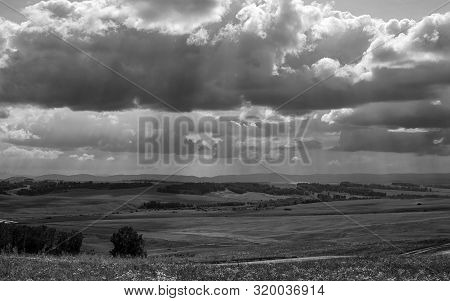Black And White Landscape Agricultural Fields, Forest, Road, Sunlight Breaking Through The Clouds