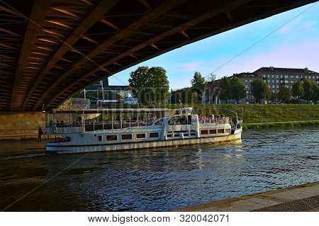 Vilnius, Lithuania - August 24, 2019: White Riverboat With Passengers On Board On The Neris River Pa