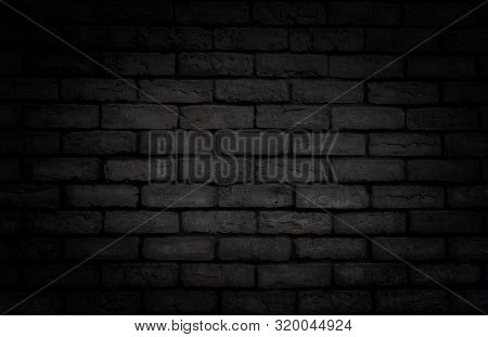 Black Rustic Texture Black Old Brick Wall Surface. Uneven Painted Plaster. Black Facade Background.