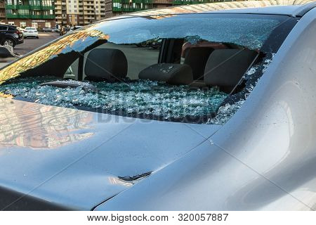 Broken Rear Glass Of Car, Spread Fragments Of Glass On Asphalt
