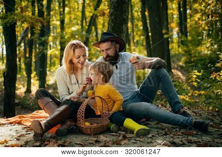 Mother Father And Small Son Picnic. Picnic In Nature. Country Style Family. Meaning Of Happy Family.