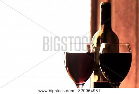 Red Wine In A Wine Glass With A Bottle Of Wine, Celebration Of A Moment With A Glass Of Wine, Exquis