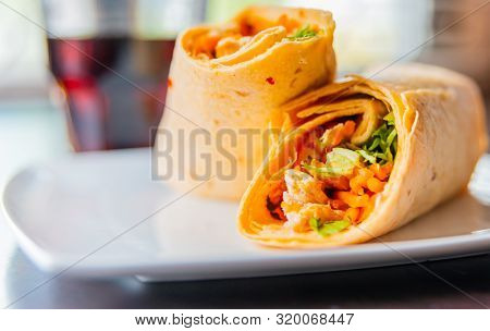 Chicken Breast With Piri Piri Sauce And Lettuce In A Chili Tortilla Wrap