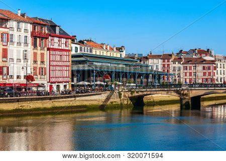 Bayonne, France - September 19, 2018: Main Public Market And Colorful Houses At The Nive River Emban