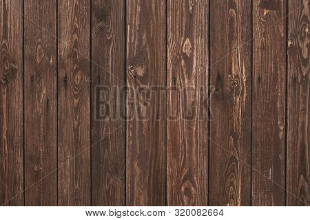 Old Shabby Wooden Fence. Abstract Pattern Texture Background. Brown Faded Boards. Oak Bars, Logs. Wo