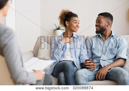 Marriage Reconciliation. Happy Black Spouses Sharing Good News With Marital Counselor. Selective Foc