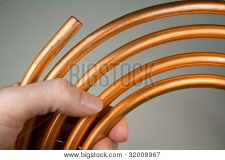 New Copper Water Pipe Held in Hand