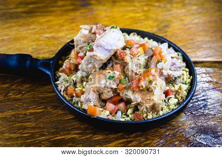 Pork Ribs With Crumbs, Chopped Vegetables And Onion. Brazillian Tipical Food.