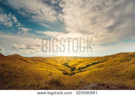 Beautiful panorama landscape Wairinding hill, Waingapu, East Sumba, East Nusa Tenggara, Indonesia. Wild nature background. Travel, holidays recreation