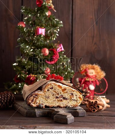 Stollen A Traditional European Cake With Nuts And Candied Fruit, Is Dusted With Icing Sugar On A Bro