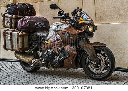 Custom Modern Motorcycle Bmw With Parts That Mimics Rust Parked In Small Square, Sibiu