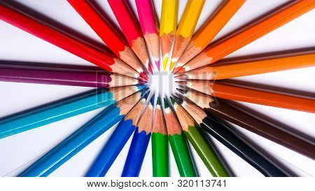 Color Pencils In A Close Circle. They Are Sharpened And Pointy Towards The Center.