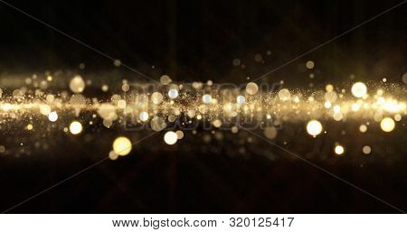 Gold glitter, light particles shine bokeh effect on black background. Shining gold sparks and glittering sparkling light glow, shimmering magic bright glitter glare
