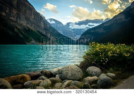 Idyllic Atmosphere On The Way Around Lake Louise In Banff, In The Rocky Mountains, Banff National Pa