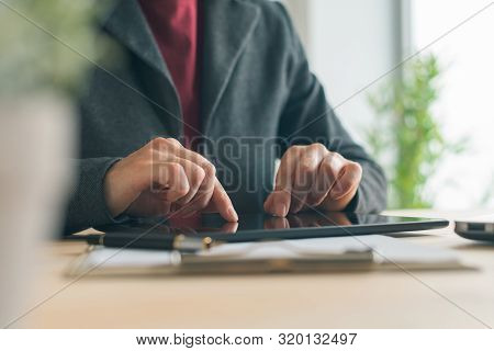 Businesswoman Using Tablet In Office, Modern Contemporary Technology Gadgets In Business Operations