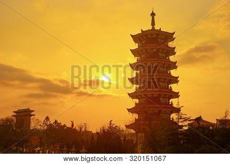 SHANGHAI, CHINA - CIRCA FEBRUARY, 2013: Chinese style pagoda during sunset in Shanghai.