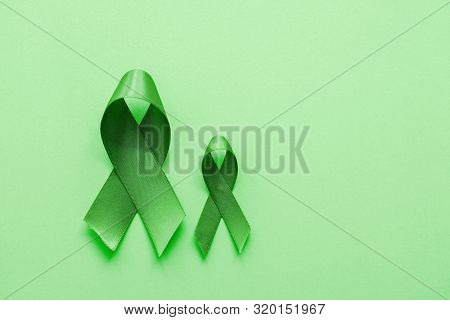Lime Green Ribbons On Green Background, Mental Health Awareness And Lymphoma Awareness, World Mental