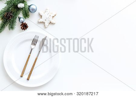 Table Setting With Spruce, Plate, Flatware On White Background Top View Mockup