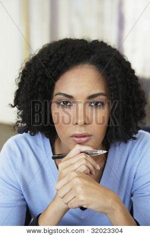 African businesswoman holding pen