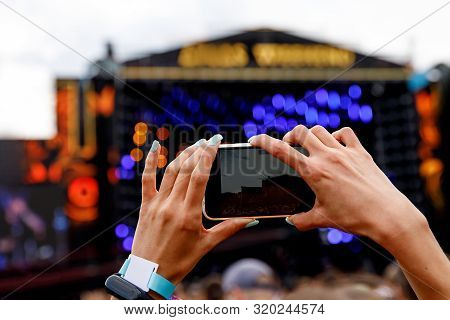 Recording A Concert On A Mobile Phone, Outdoor Stage.