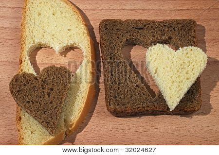 Pieces Of White And Brown Bread With The Hearts Cut Out From Bread
