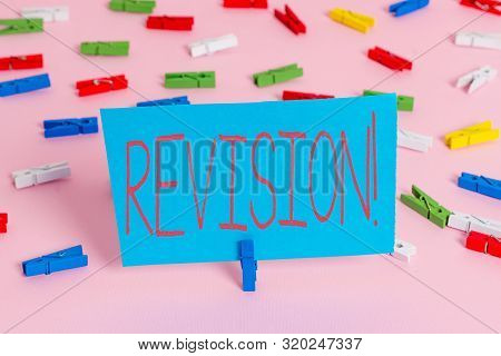 Writing note showing Revision. Business photo showcasing action of revising over someone like auditing or accounting Colored clothespin papers empty reminder pink floor office pin. poster