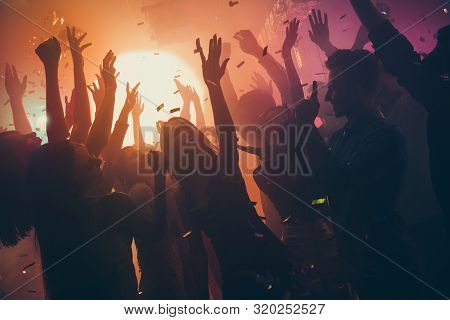 Photo Of Many Party People Buddies Dancing Yellow Lights Confetti Flying Everywhere Nightclub Event