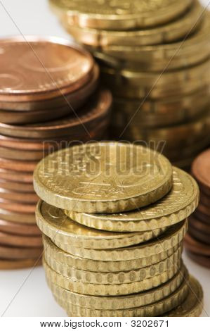 10 Cent Coin On Pile Of Euros