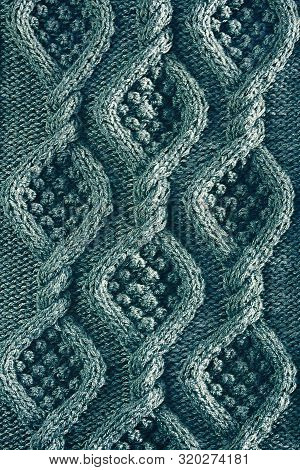 Vertical Background Texture Knitted Canvas With Aran Patterns Close Up In Turquoise Color