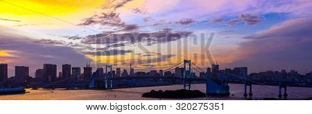 Panorama Aerial view of Tokyo skylines with Rainbow bridge and tokyo tower over Tokyo bay Sunset Twilight from Odaiba in Tokyo city Kanto Japan.