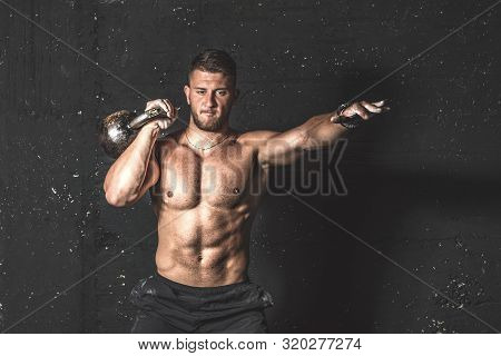 Kettlebell Workout, Young Strong Sweaty Focused Fit Muscular Man With Big Muscles Holding Heavy Kett