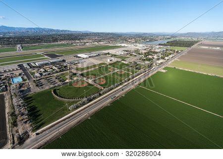 Aerial view of farmland and baseball fields near Camarillo Airport in scenic Ventura County, California.