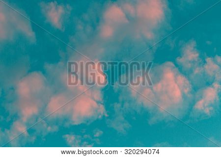 Pink Clouds And Blue Sky. Toned Image