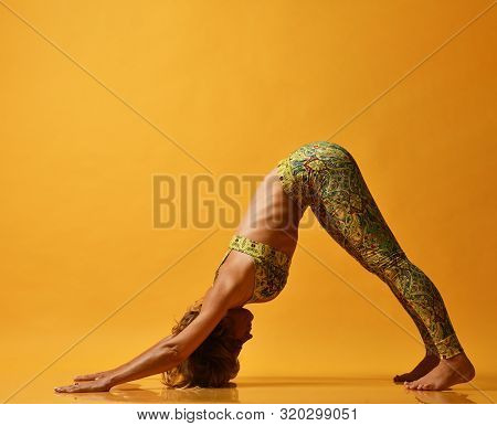 Beautiful Young Woman Working Out Green Floral Sportswear On A Yellow Wall Doing Yoga Or Pilates. Th