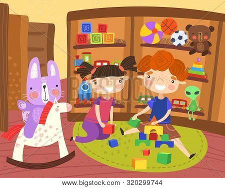 Happy Little Boy And Girl Playing In A Toy Store With Their Toys As Their Cute Pet Rabbit Takes A Ri