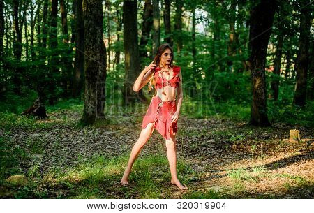 Wild Woman In Forest. Forest Fairy. Living Wild Life Untouched Nature. Sexy Girl Early Stage In The