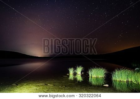 Night Sky Above Vrazje Lake In Durmitor In Montenegro, Europe