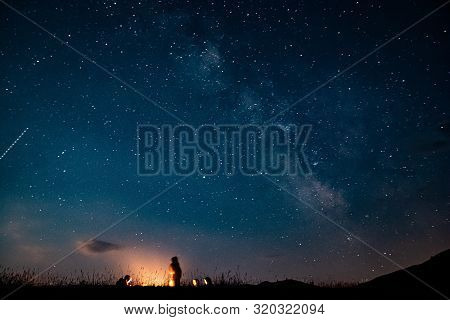 People By Fire Camp With Milky Way On The Sky Near Durmitor In Montenegro, Europe