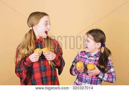 We All Love Desserts. Small Children Happy Smiling With Cupcake Dessert In Hands. Happy Little Girls