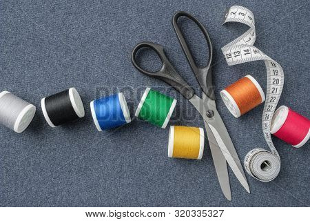 Sewing Items: Tailoring Scissors, Measuring Tape, Spools Of Multicolored Threads. Sewing Accessories