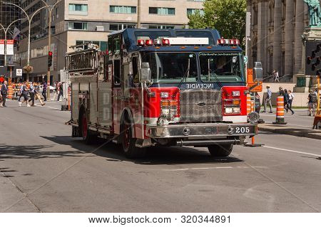 Montreal, Canada - 03 September 2019: Firetruck Driving Fast On Boulevard René Lévesque.