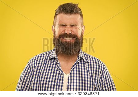 Just Sneezed. Man Bearded Hipster With Sneezing Face Closed Eyes Close Up Yellow Background. Brutal