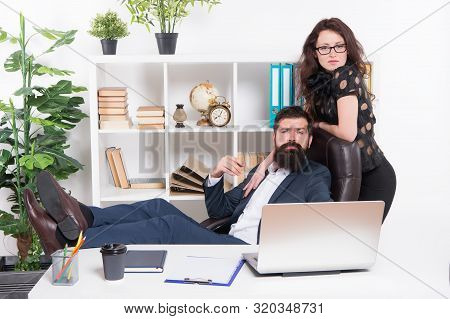 Working Couple. Couple Of Lovers At Workplace. Couple In Love Conducting Affair At Work. Romantic Co