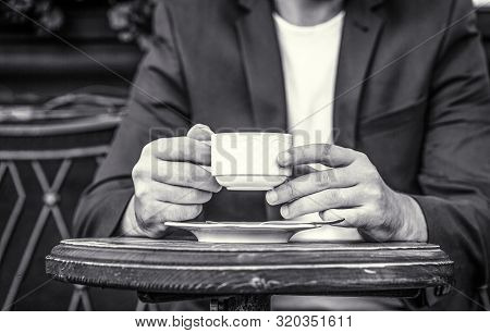 Cup Of Coffee. Cappuccino And Black Espresso Coffe Cup. Coffee Drink. Close Up Of A Man Hands Holdin